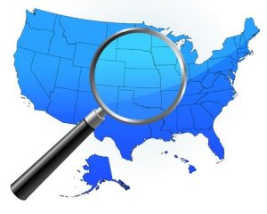Map of the United States with a magnifying glass