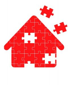 Puzzle in shape of a red house with pieces missing